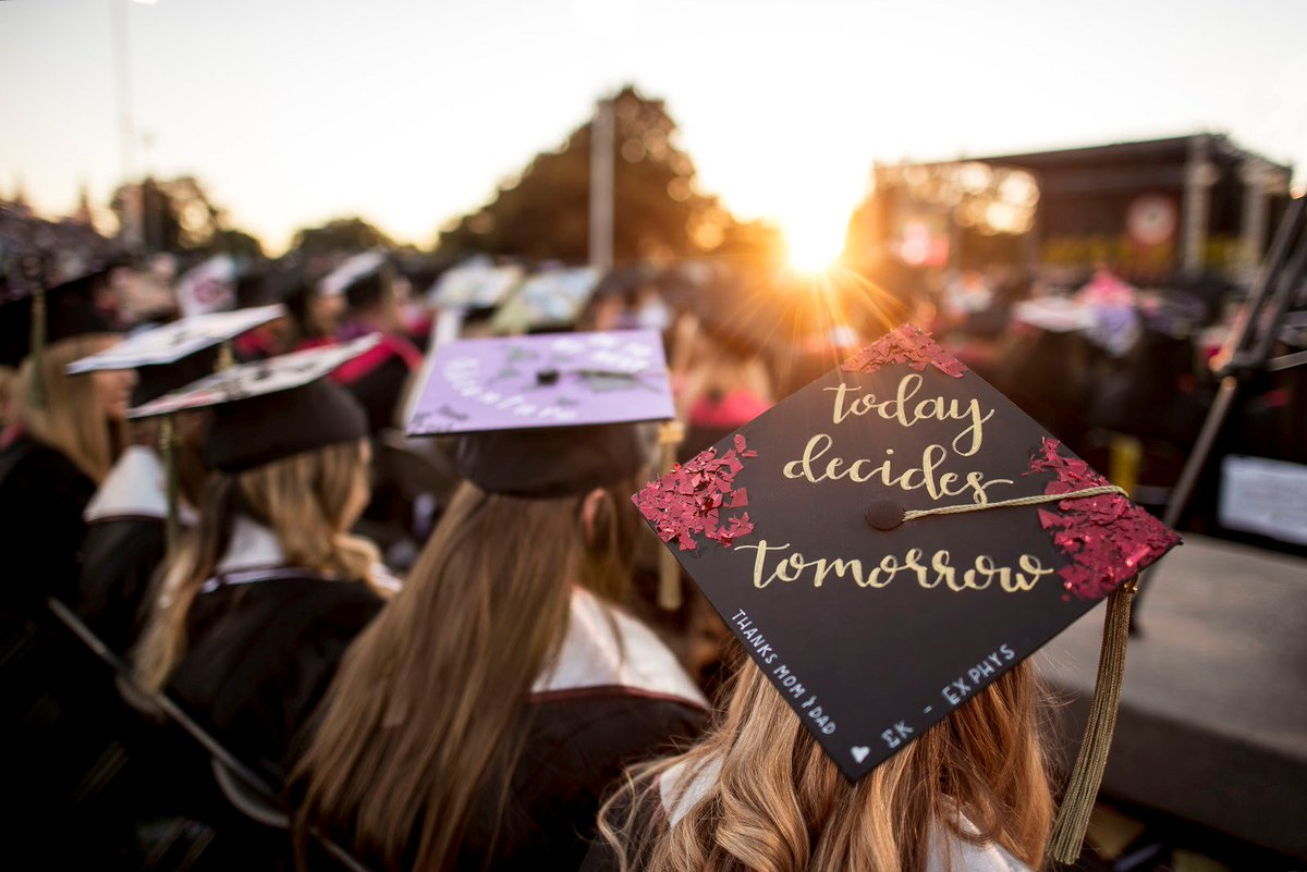 """""""Today decides"""" tomorrow is on the graduation cap of a student at commencement."""