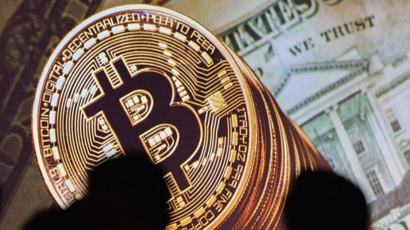 Bitcoin surges to new high on reports software 'fork' suspended