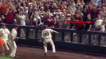 Did This Flashing Fan Cause Arkansas To Choke Away The College World Series?