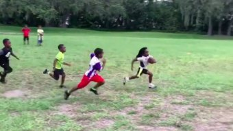 This 6-Year-Old Flag Football Player Might Be The Second Coming Of Barry Sanders