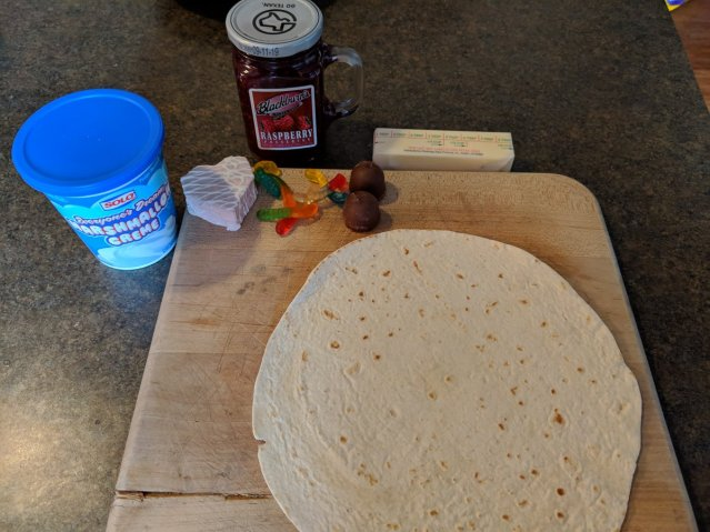 One tortilla, one cake, two cordials, six gummi worms, and the marshmallow creme and raspberry preserves.