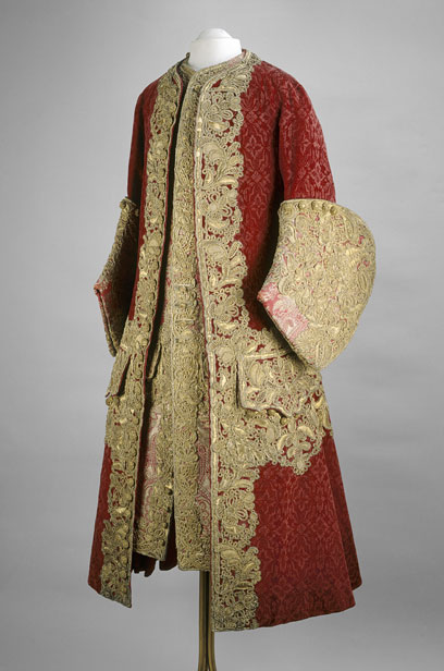This elegant coat and waistcoat demonstrate how closely the Russian court was following European fashion in the 1720s. The deep, curved cuff is the 'boot-cuff' sleeve that was in fashion from 1725 to 1735. The richness of the gold lace suggests that the ensemble was intended for Peter II's wedding to Princess Ekaterina Dolgorukaya, but unfortunately Peter died of smallpox the morning of the ceremony, on 30 January 1730. © The Moscow Kremlin Museums