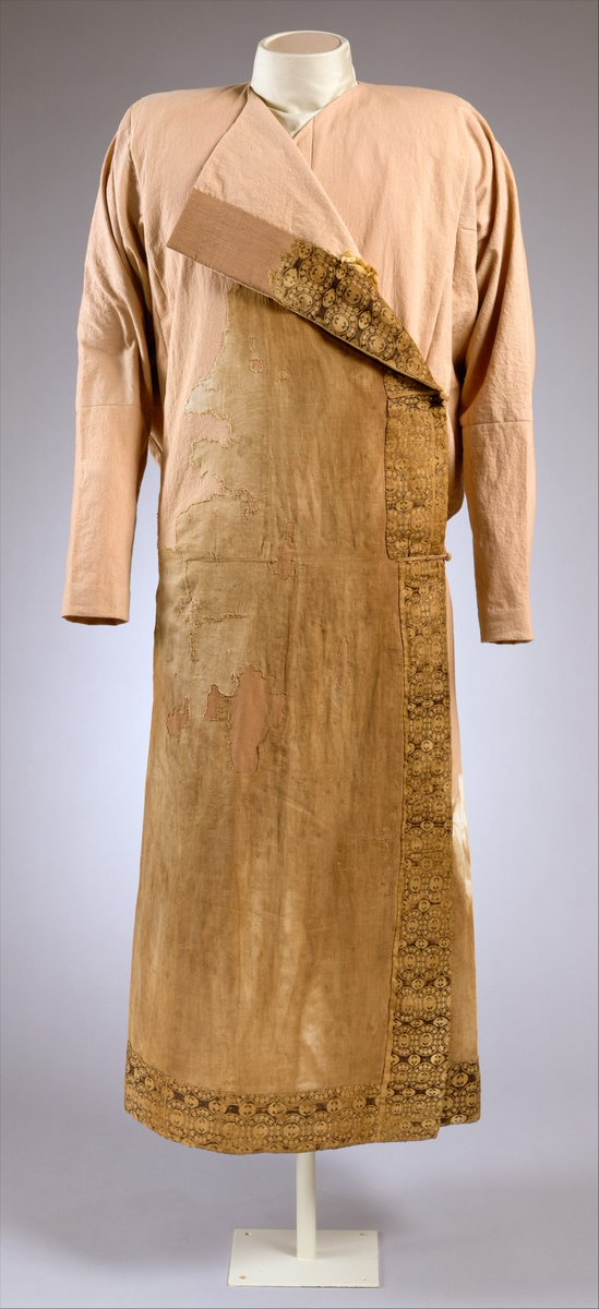 The original linen coat (caftan), preserved in part from the neck to the bottom of the hem, is made of finely woven linen. A decorative strip of large-patterned silk is sewn along the exterior and interior edges of the caftan. A minute fragment of fur preserved as the caftan's interior attests to its fur lining. The woven patterns on the silk borders of the caftan include motifs such as the rosettes and stylized animal patterns enclosed within beaded roundels, which were widespread in Iranian and Central Asian textiles of the sixth to ninth century. The colors used in the textile include a now-faded dark blue, yellow, red, and white on a dark brown ground. The decorated silk fabrics are a compound twill weave (samite in modern classification) and the body of the garment is plain-weave linen. Two slits running up the back of the caftan make it particularly suitable as a riding costume. Met Museum