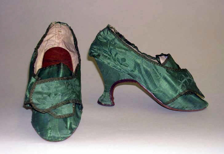 Matching green damask silk shoes to the dress previously shown. They have a flared heel and wraps around their toes.