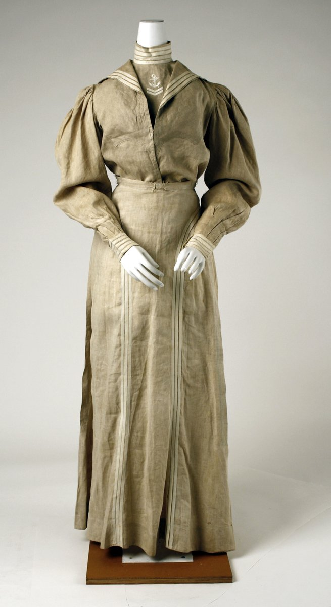 A linen sailor suit for a woman in the late 1800s. It's beige. From the Met Museum. Public domain.