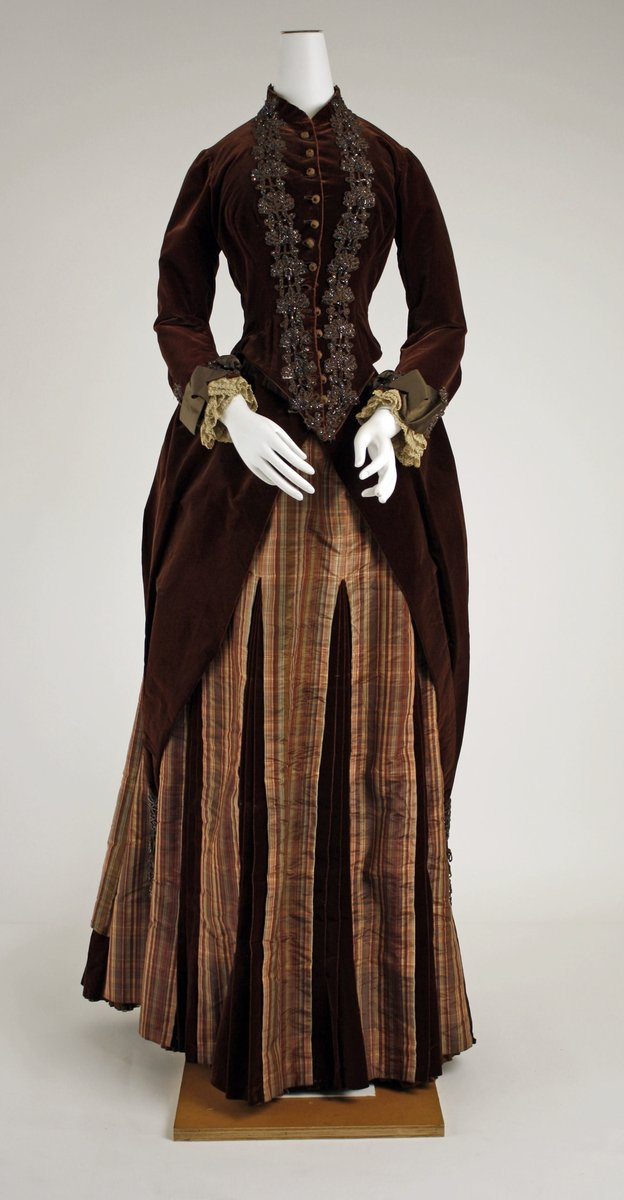 """Dress - ca 1881, velvet """"suit"""" bodice, striped and gored skirts. Embroidered lapels. High neck and lace cuffs. Met Museum."""