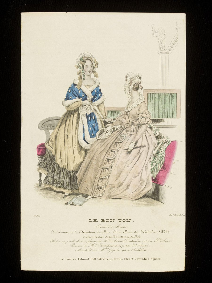 ©Victoria & Albert Museum, London - Fashion plate showing two women in an interior in day dresses, one standing in a gold dress with a blue satin wrap edged with white fur and trimmed with fur spots, the other in a fawn dress trimmed with white lace.