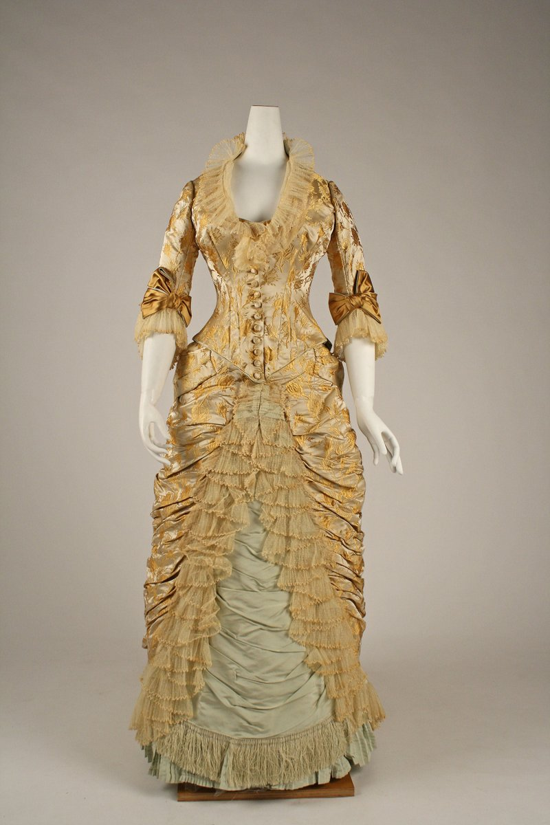 """Moss roses are distinctive for the mossy growth on their calyx lobes, hips, and flower stalks. In this dress, they are shown only as buds, the splendid anticipation of full-blown beauty. Sir Walter Scott in Lady of the Lake (1810), wrote, """"the rose is fairest when 'tis budding new."""" - Met Museum, public domain."""