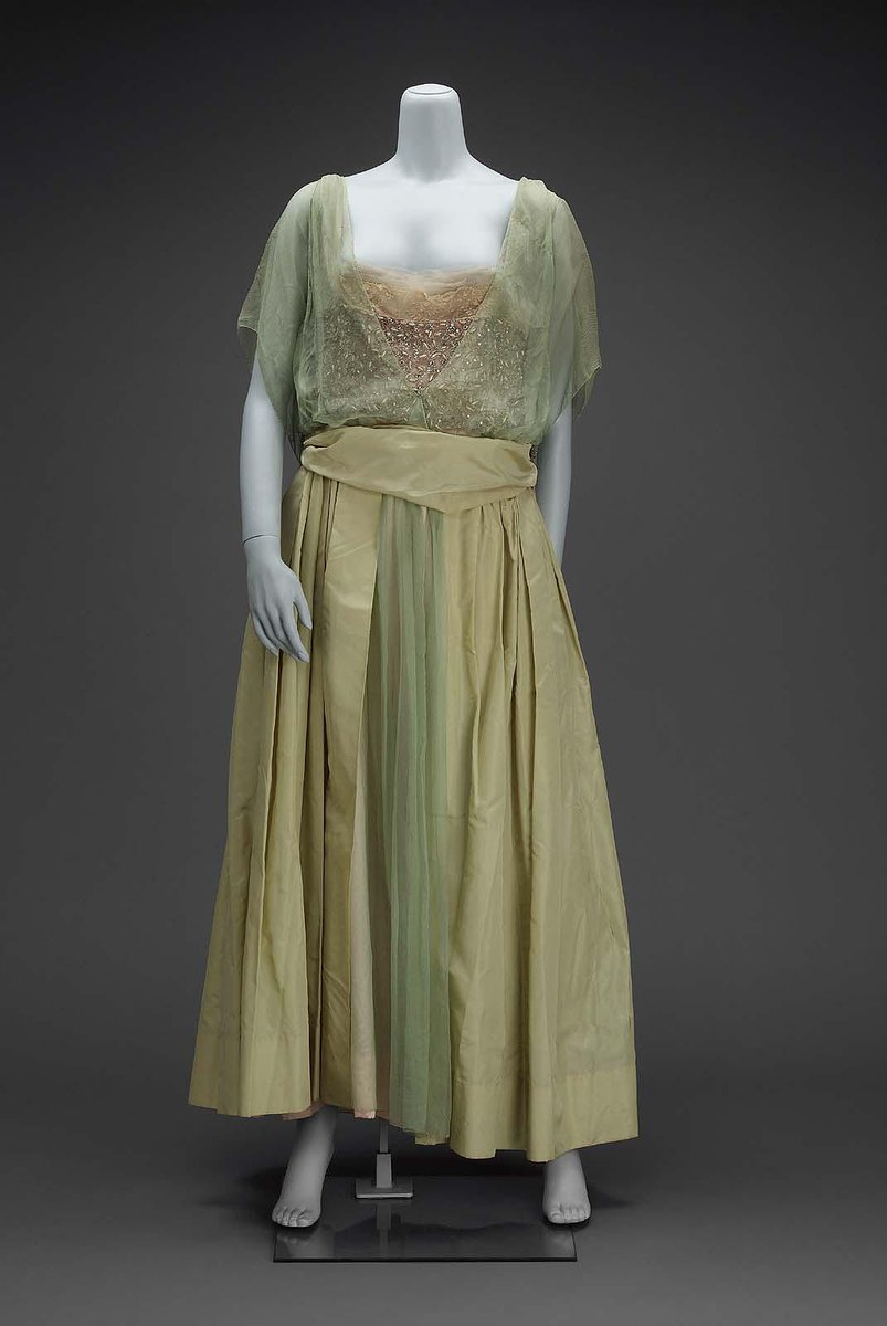 Evening dress; skirt, pale green taffeta, full with deep pouf in center back and open down center front to show green chiffon over pink satin underskirt; bodice, with deep V in center front and back, of green chiffon; wide band of silver glass bead embroidery over pink satin running around lower bodice; short sleeve formed by square of green chiffon with bead tassels on lower corner; green tafetta belt; label on belt: Farquharson and Wheelock, 724 5th Avenue, New York.