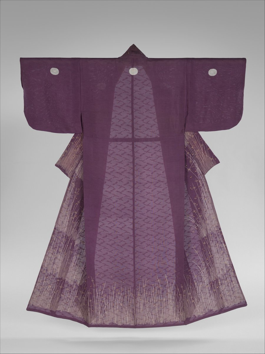 This elegant summer robe features a cooling design of grasses and drops of dew. The large circles reserved in white contain lightly painted peony crest patterns; however, from afar, the peony designs are not visible and the circles resemble the full moon above a grassy field—a classic autumnal theme. Met museum, public domain.