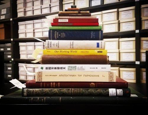 Image result for arranging books langest to smallest