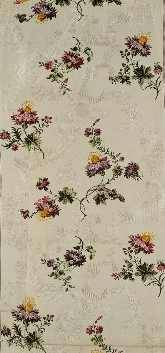 """Meandering floral vines design attributed to Garthwaite, ca 1740. - Classic """"S"""" floral vines from Garthwaite, with a damask background, on pale creme. Very lifelike flowers. Public Domain."""