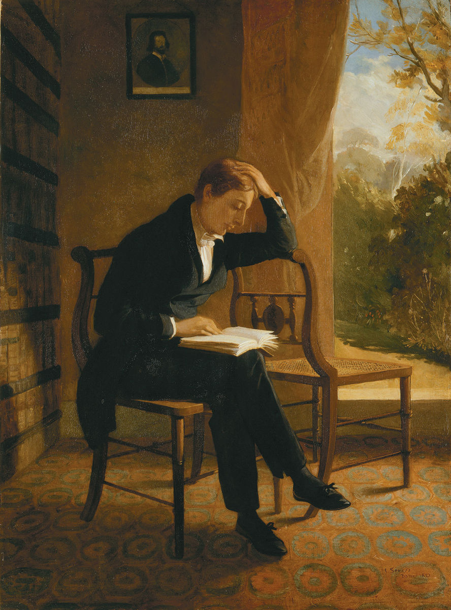 A posthumous painting of John Keats, leaning over a chair reading a book. He has fine features and reddish hair and is dressed all in black. There is an outdoor scene in the background.