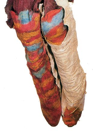 Colorful leggings in a tartan-like weave, remarkably preserved.