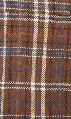 """A recreation of the """"Hami plaid"""" with brown, white, blue, red, and black dyes."""
