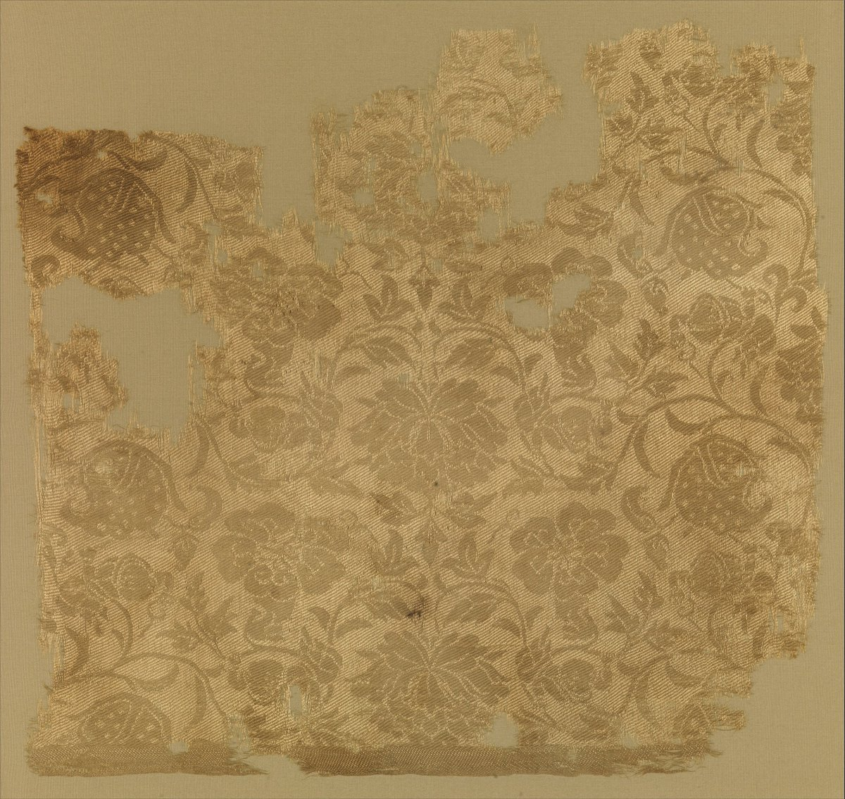Textile fragment with boys in floral scrolls - so similar to the key image, huh?