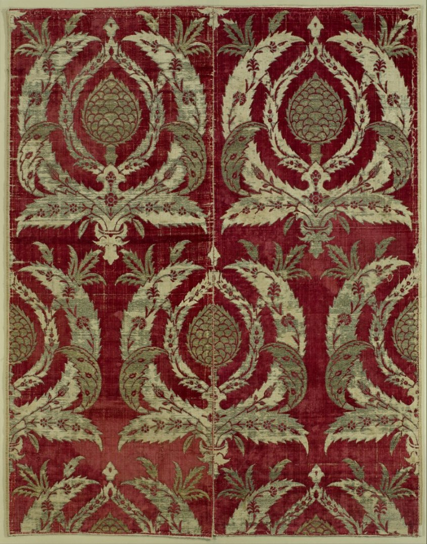 Artichoke Velvet - Ottoman Empire, 16th Century - the Met Museum  Bursa, a mountainside city in northwest Anatolia about 60 kilometers from Istanbul, was from the mid-fifteenth to the seventeenth centuries the major production center of velvets in the Ottoman empire. This splendid panel, composed of two loom-width pieces sewn together, typifies Bursa velvet weaving in the late sixteenth century. The motifs, especially the feathery leaves embracing the artichokes, are among the most frequently used by Ottoman weavers (and ceramicists) in this period. Fabrics such as this one were primarily employed in furnishings, such as cushions, curtains, and wall hangings, in the Ottoman empire. The many examples exported to Europe, on the other hand, were most often used in ceremonial costumes.