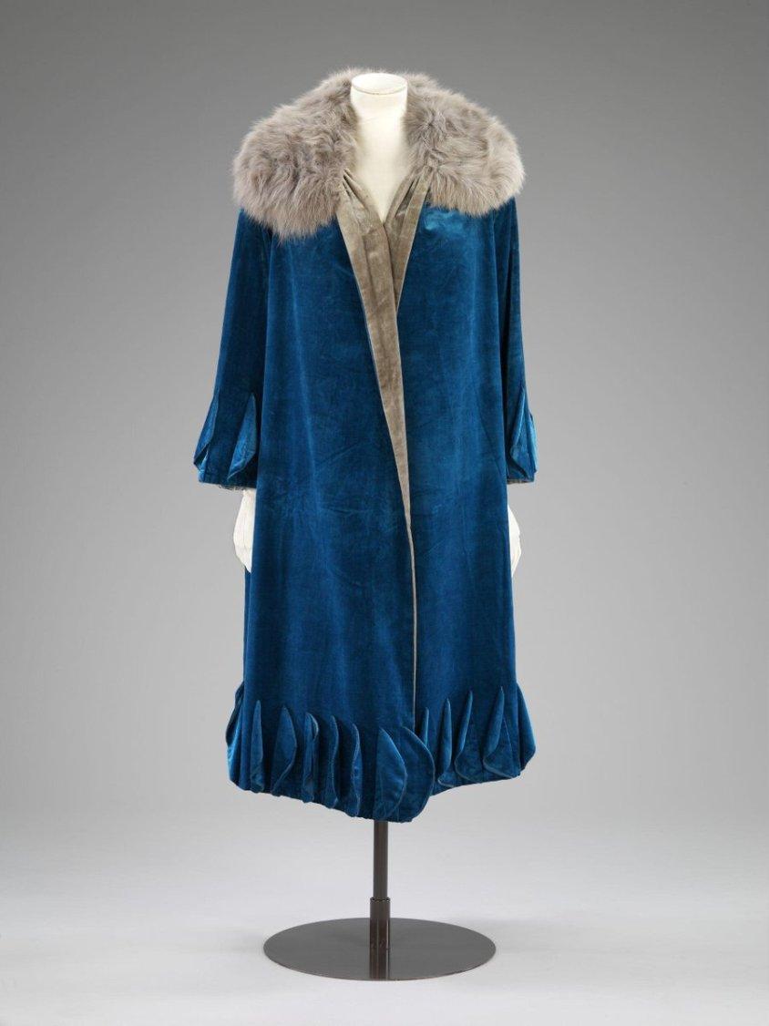 Medium blue velvet overcoat with fur shoulders, V&A, dating from the 1920s