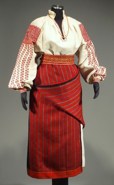 Dress with red stripes and highly ornate red sleeves from Ukraine. Shoulders of red, deep v, gathered sleeves.