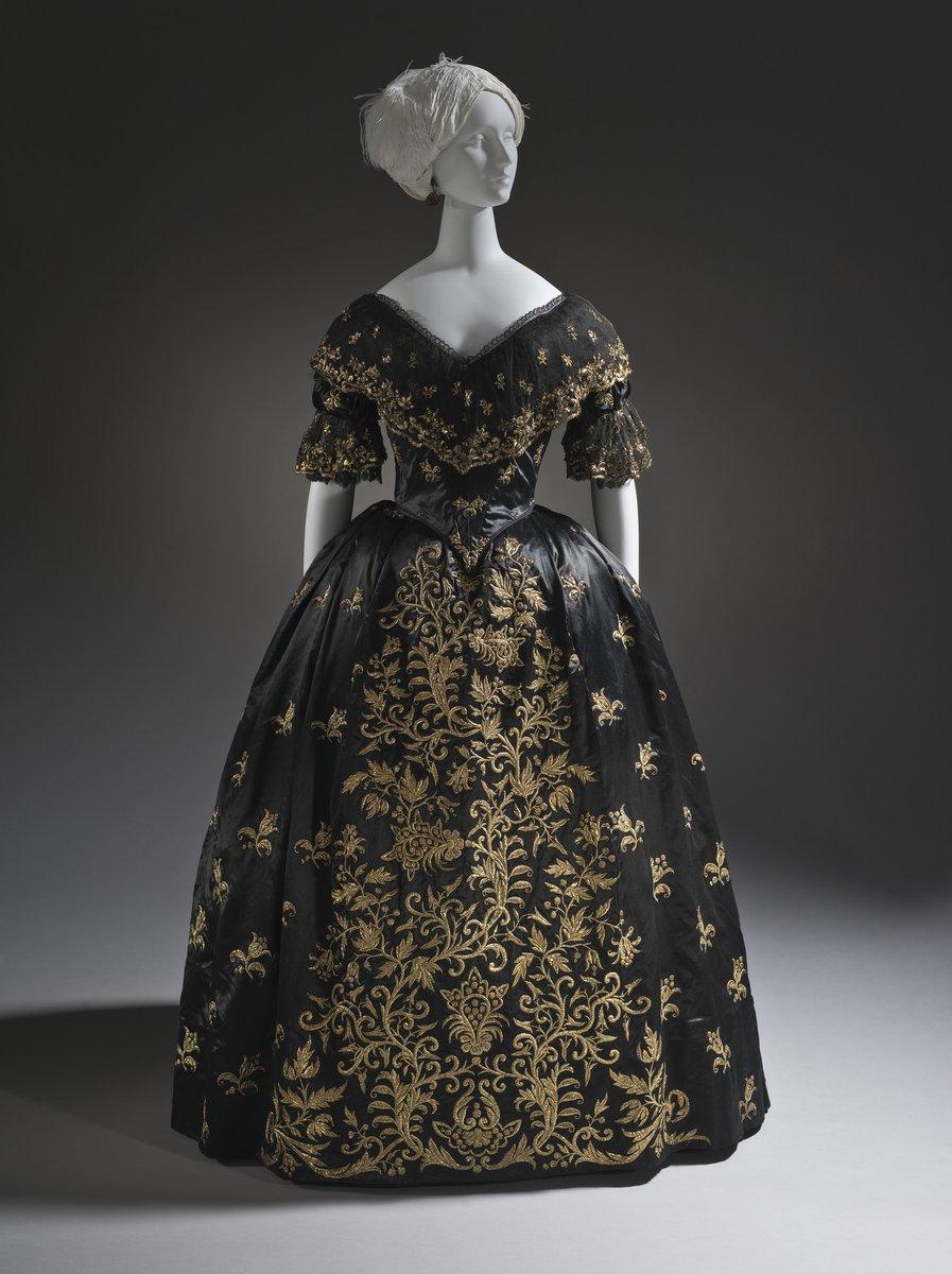 Woman's Dress and Train Portugal, circa 1845 Costumes; principal attire (entire body) a) Silk satin with metallic-thread embroidery and silk net (tulle) trim; b-c) Silk satin with metallic-thread embroidery a) Bodice center back length: 10 1/8 in. (25.72 cm); b) Petticoat center back length: 44 in. (111.76 cm); c) Train: 120 x 54 in. (304.8 x 137.16 cm); d) Fancy dress bodice center back length: 14 1/2 in. (36.83 cm); e) Standing Whisk (Medici) Collar: 15 x 17 in. (38.1 x 43.18 cm) - LACMA