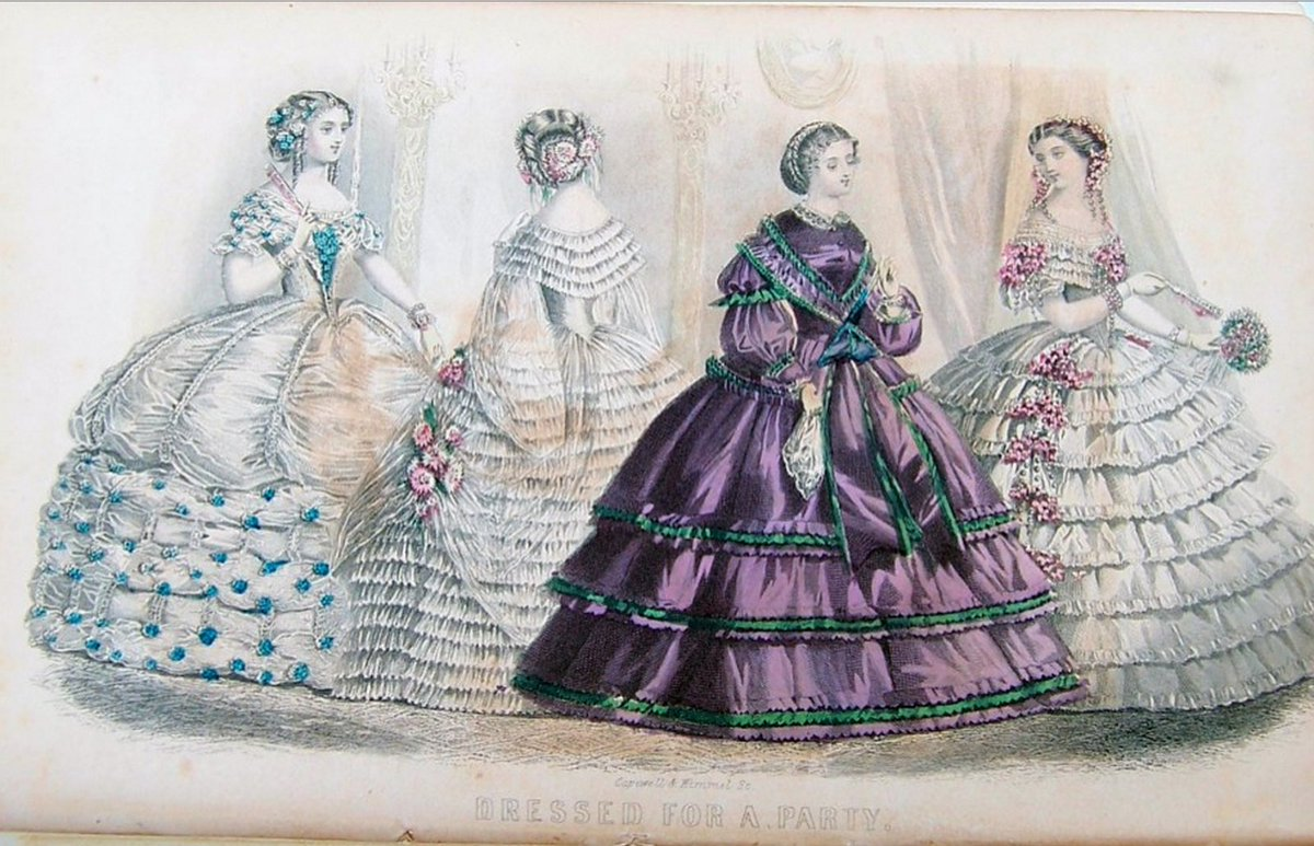 A vintage fashion plate of women in very wide dresses in many layers, with many folds. Three are in white, one is in deep purple and green. Public domain.