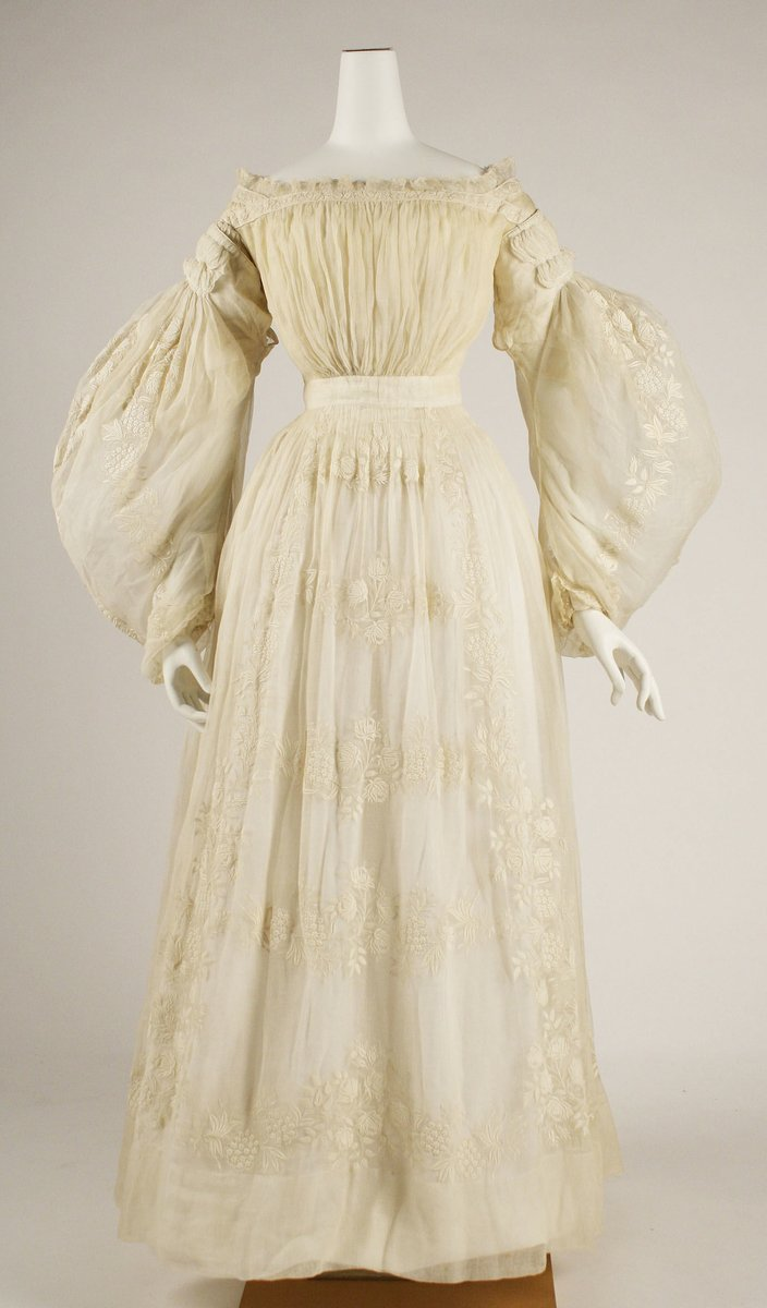 French dress, 1837. Wedding gown. Puffed romantic sleeves and slightly lower waist, more ivory design. Met Museum, public domain.