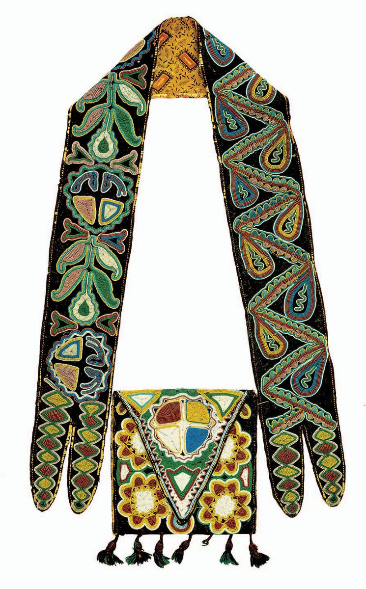 Creek man's shoulder bag ca. 1810–30. Wool, cotton, silk ribbon, glass beads, 25¾ inches. The Detroit Institute of Arts, Founder's Society, DTR 781294. Purchased with funds from the Flint Ink Corporation, 1988.29. Photography: The Detroit Institute of Arts.  - Vivid bright colors in flower and leaf patterns -- two long straps and a bag in the middle with a triangular flap and tassels.