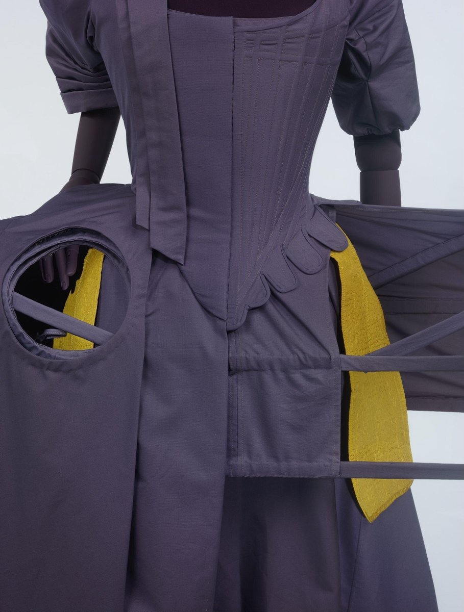 Showing how pockets would fit in an 18th century ensemble, hidden beneath the folds of the overskirt and over the petticoat. ©Victoria and Albert Museum, London