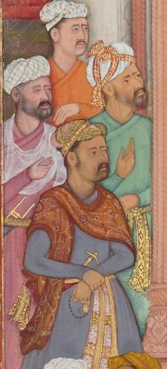A closeup of Abu'l-Fazl ibn Mubarak presenting Akbarnama to the Grand Mogul Akbar. Mughal miniature. Four men sit together, and the closest is wearing paisley on a shawl. Via Wikimedia Commons.