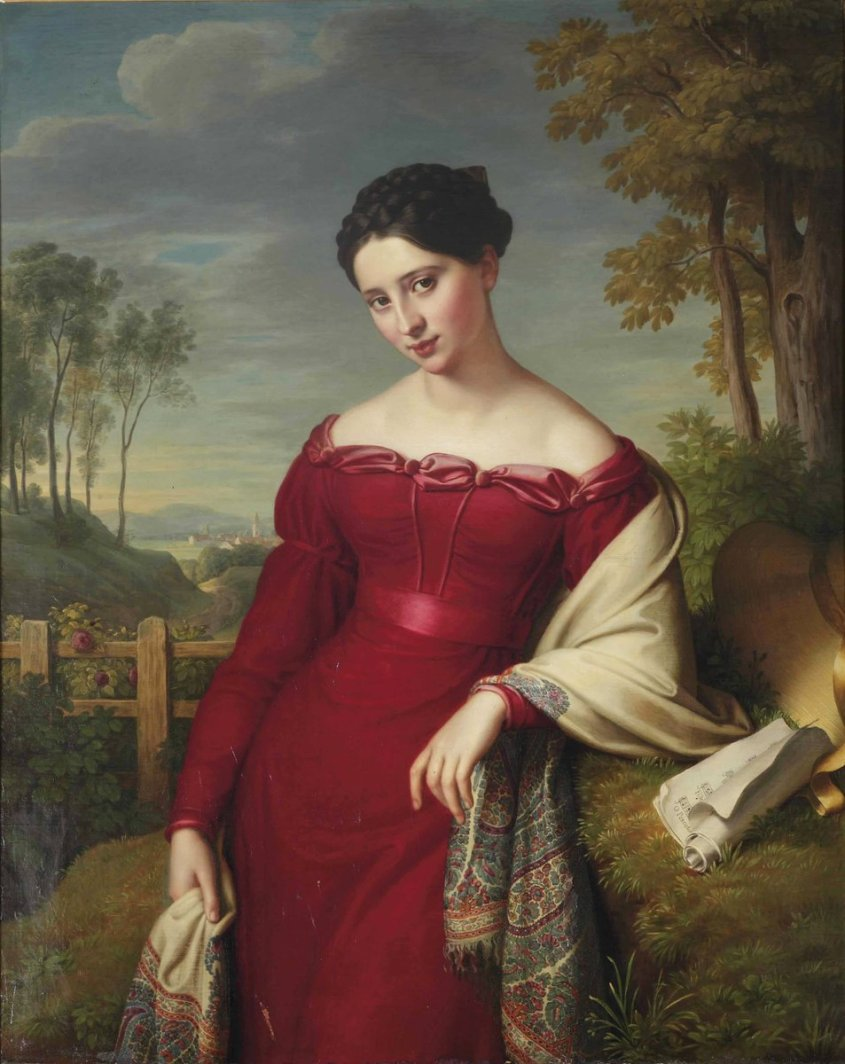 A woman in a red dress in 1824 with a Paisley shawl around her shoulders. The dress has satin on the top and belt, and may be velvet. The shawl is ivory with a boteh pattern around the edges. She is looking at the painter and has her hair up in braids. She sits in a bucolic landscape. Image via Wikimedia Commons - public domain.
