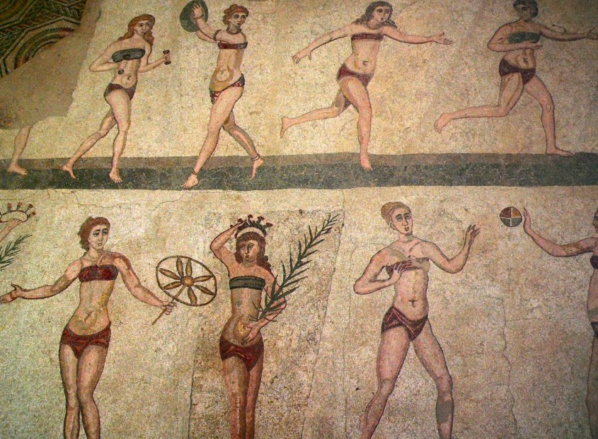 Women on a mosaic playing various sports in two-piece undergarments -- one looks like a bandeau bra, the other like a loincloth.