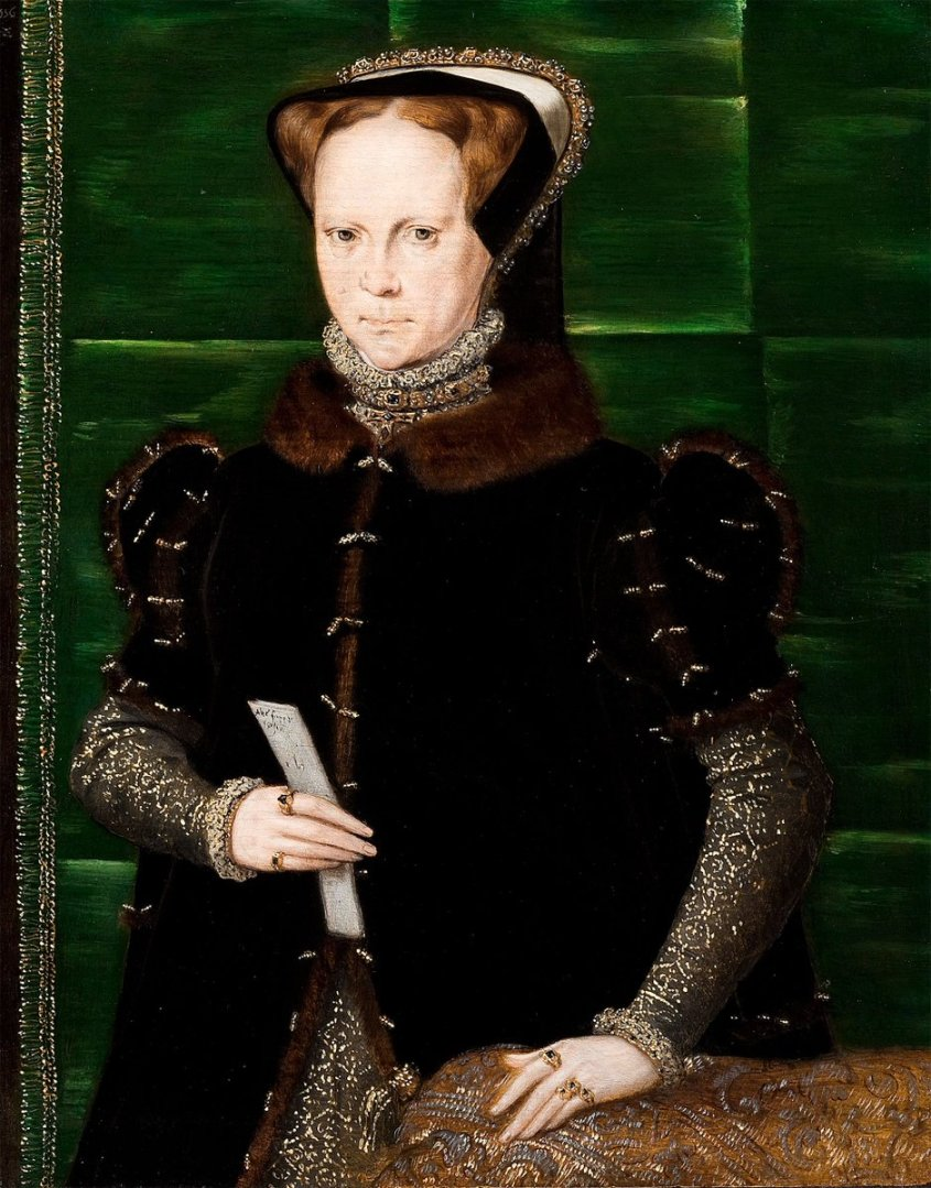 "Here Mary I is wearing a different style, ""French"" gown that clasps in the front. It's trimmed with fur. She looks more careworn in this image."