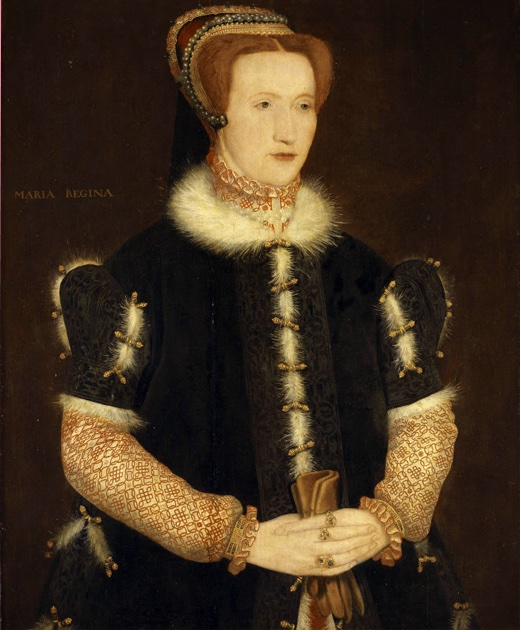 Bess of Hardwick, dressed in a gown with embroidered sleeves, hemmed in fur. She has red hair and looks... possibly related to the royals, but that's probably more of a beauty standards thing. She's holding a pair of gloves.
