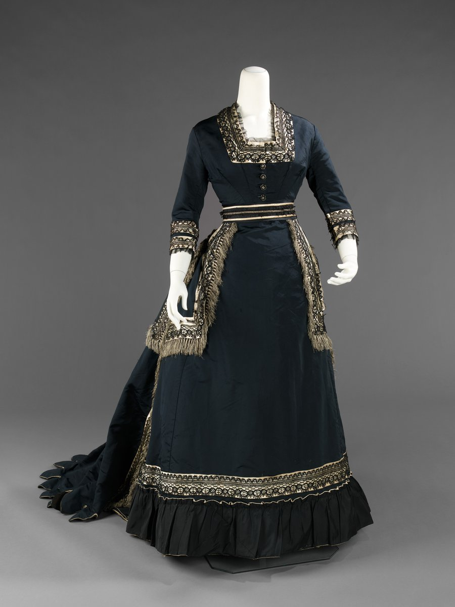 From the Met - This half mourning dress shows the care with which additional colors were implemented in mourning attire with the white accents carefully placed to not overwhelm the black and create a visually appealing transitional garment.