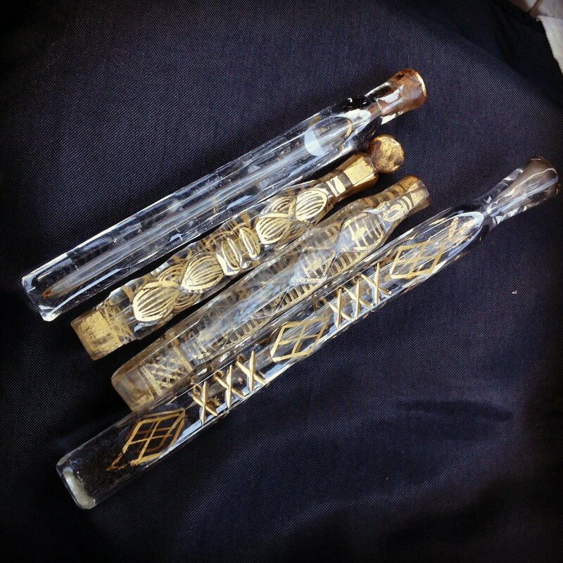 Katie Kierstead/Roses & Rue Antiques - via Atlas Obscura - long vials of perfume bottles. Very pretty. Not tear catchers.