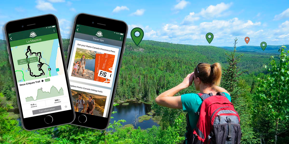 A young woman looks at the scenery in the distance while hiking.  Phones show trail maps and travel tips available in the Parks Canada mobile app.