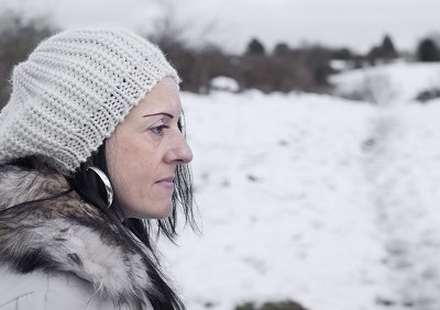 worried woman in snow covered fields landscape