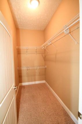 Spacious walk-in closet in master bedroom