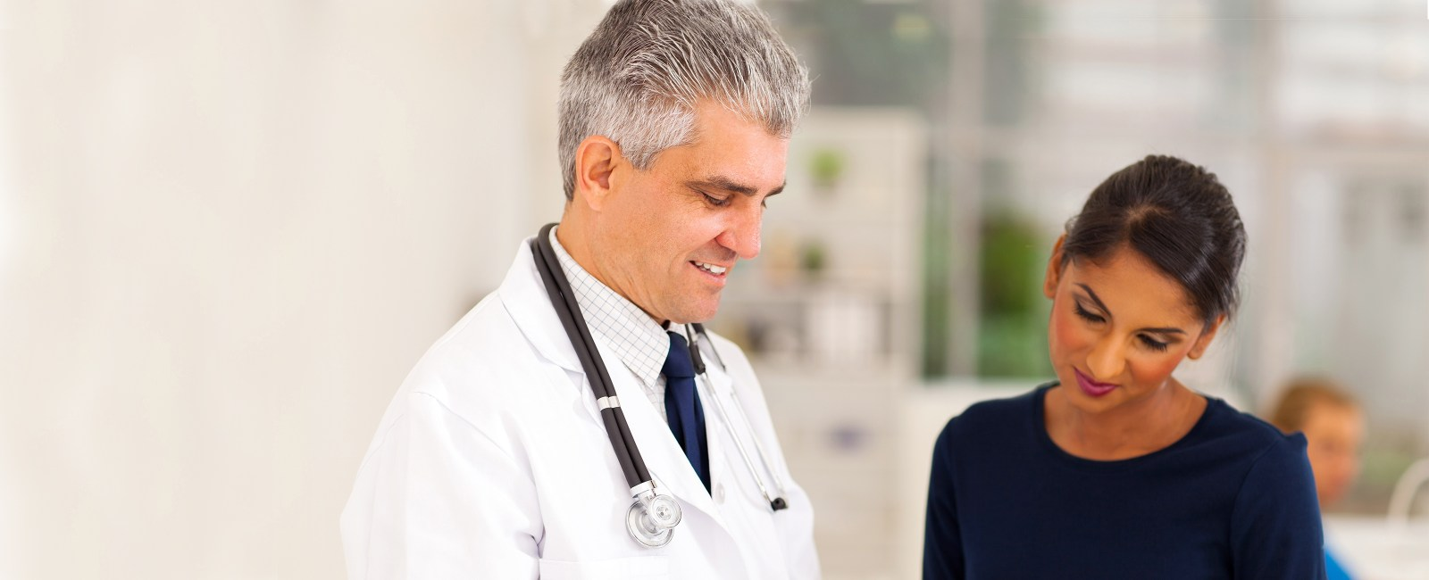 patient speaking with doctor