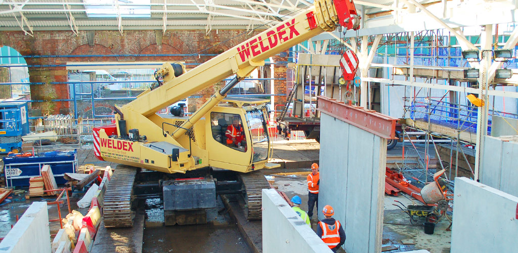 Only inches to spare. The crawler crane working within the former engine shed