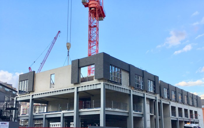 PCE installing offsite produced sandwich panels in Manchester