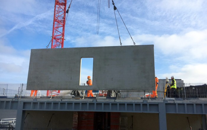 Offsite manufactured precast concrete unit being craned in at Dakota Hotel Manchester