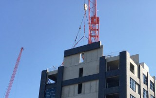 Offsite engineered precast sandwich panels being installed at Manchester Hotel