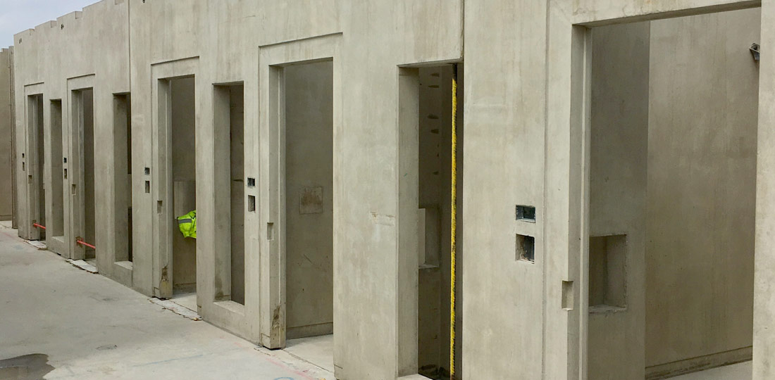 Structural precast components being utilised including columns precast walls stairs and landings