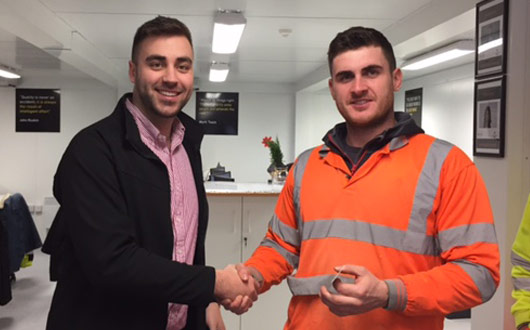 Lee Adams of PCE Ltd being presented with his safety award