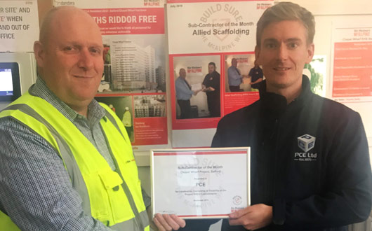 PCEs Adam Clarke is receiving the certificate for SRM subcontractor of the month award