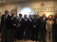 WWII veterans stand together for photos - PCHC Director George Ing amongst them