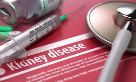 Kidney disease. Medical Concept on Red Background.
