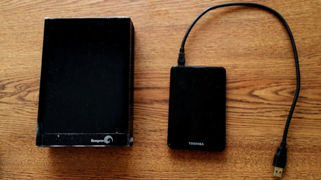Two different external drives. The one on the left has a larger desktop hard drive inside which requires a power adapter and the one on the right contains a USB powered laptop drive inside.
