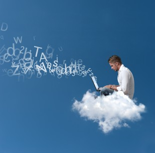 Concept of a businessman that works over a cloud